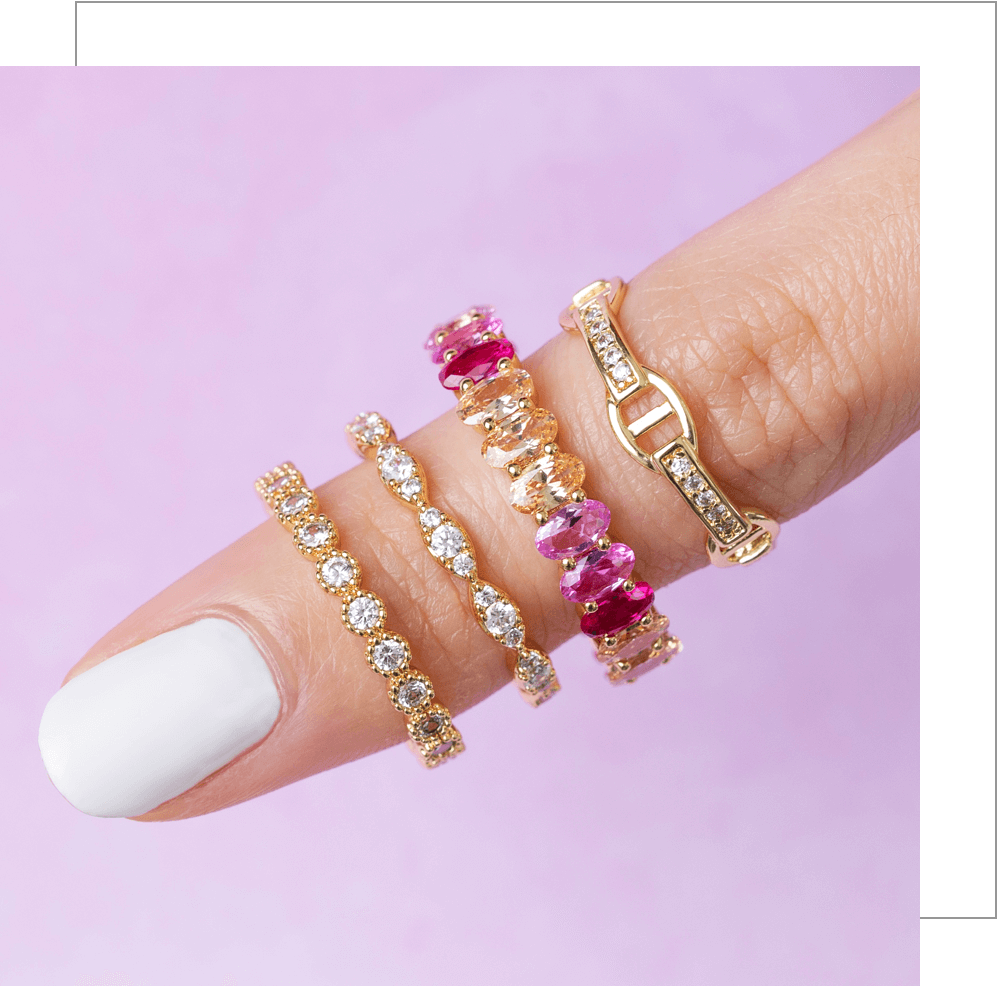 woman finger with 4 rings